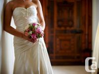 Strapless ivory satin bridal gown with classy beading,