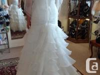Beautiful Ella Rosa wedding dress size 10 Color: Ivory,
