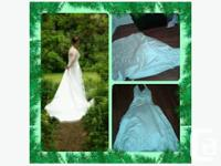 I am selling a $1200.00 wedding gown for $500/obo.