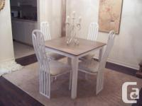 I have a beautiful white dining table set for sale. The
