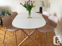 Beautiful white oval shaped dining table with birch