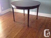 This is a wonderful dining room table and four chairs,