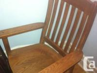 Large solid wooden chair. Very comfortable.  Will look