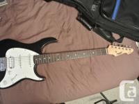 Used Peavey Raptor EXP - black in color with minor