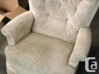 Selling an off-white shaking chair/recliner for $65 or