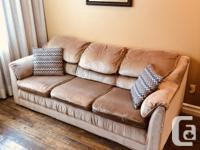 This is a nice sofa upholstered in a beige coloured