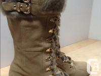 Like new - worn once Leather upper - manmade lining and