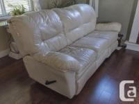 Beige leather Sofa or Couch. Good used condition,