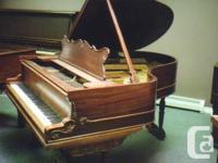 "Bell grand piano 5'8"" in mahogany Art case."