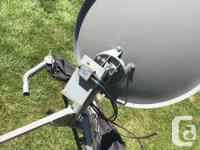 Bell satellite dish and tripod. The tripod was over