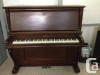 Bell Upright Piano.  Lovingly cared for.  Tuned and