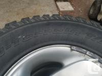 Tires with rims. Came off a 2000 Dodge Ram 1500.