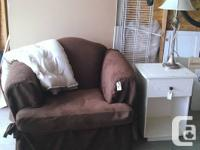 Big, comfy chair with chocolate brown slip cover. Seat