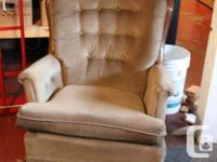 This is a large comfortable armchair upholstered with a