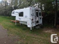 "2004 9'6""Bigfoot 1500 collection Camper, Very tidy and"