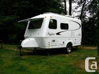 17.5 foot 2006 Bigfoot Travel Trailer is in a lesson of