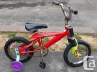 bike in good condition with new training wheels and