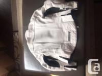 White with black accent woman�s bike jacket. Padding on