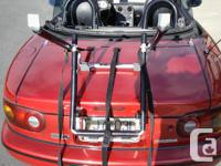 THIS LIKE NEW BIKE CARRIER FOR THE BACK OF YOUR CAR OR