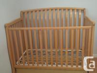 Like new, sturdy solid birch crib by Sorelle. It