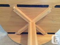 Solid wood bistro table with two wood chairs. The table