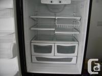 Black Amana frost free fridge with lower freezer, works
