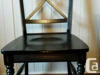 Beautiful weathered black table with 6 matching chairs.