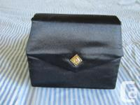 Purse without handle 5 inches high 6 1/2 inches wide
