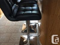 2 Black Faux Leather Bar Stools, with chrome, base is