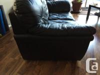 Black Faux Leather Loveseat. Has some small tears in