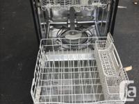Black Kenmore dishwasher with stainless still interior.