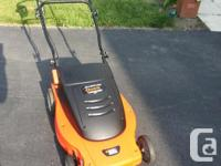 "Grass hog electrical 19"" Mulching mower. With yard bag"