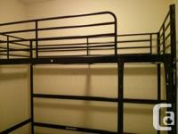 Twin bed sized black metal loft bed. Very sturdy and in
