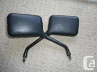 Pair of black EMCO motorcycle mirrors. Nothing fancy,