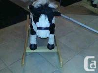 BARELY USED ROCKING HORSE. PLUSH BLACK AND WHITE. TAIL