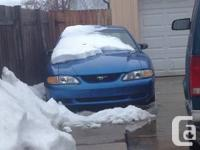 I am selling/trading my blue 94 mustang. KBB says