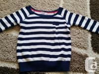 Blue and white striped shirt. 3/4 sleeves. Good