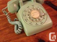 Vintage Rotary phone from the '60s (the bottom plate
