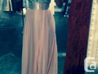 I am selling a blush coloured gown that I wore once in