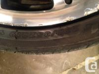 Stock 19 inch rims and Maxtrek Ingens A1 tires from a