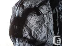 This is a used BMW motorcycle jacket. Comes with liner