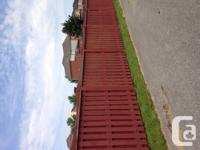 Wooden fence panels, pressure treated wood, stained,