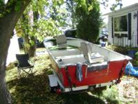 14ft Fiberglass boat and trailer, includes 2 sets of