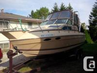 23 foot sun runner cabin cruiser with trailer.  Trailer