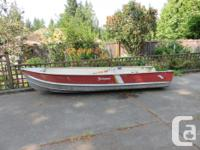 14' Springbok boat, with 20 hp motor and custom built