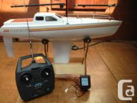 Great looking remote control sailboat with backup