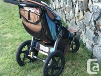 Brown and blue BOB jogging stroller. In good used shape