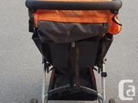 Baby stroller with snack tray, weather shield and pump.