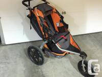 Orange and black Bob Revolution stroller, 3 years old,