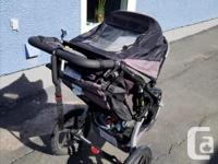Well loved BOB stroller that was used for 1 child. In